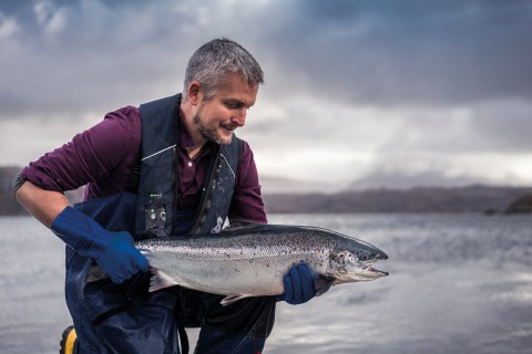 Loch Duart Husbandry Man with salmon