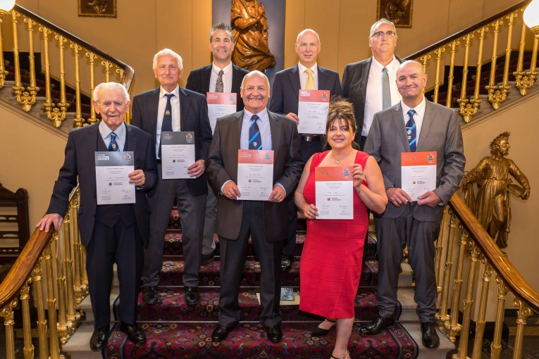 Master and Companion Fishmongers show off their certificates on the steps of Fishmongers' Hall
